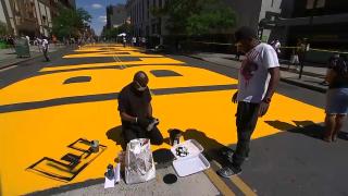 artists paint Black Lives Matter mural