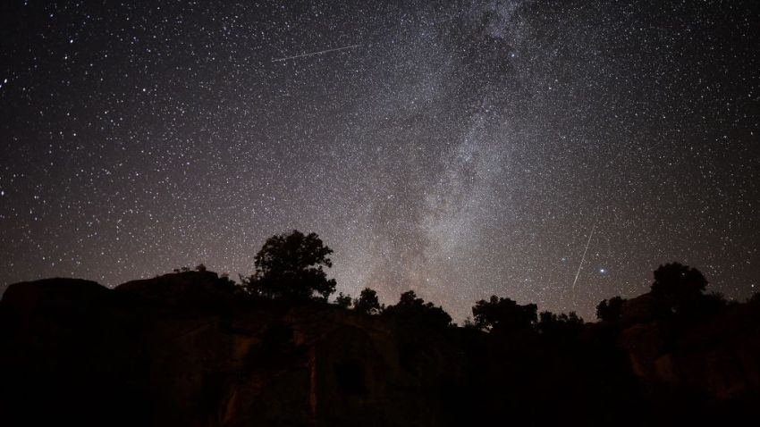 Perseid meteors streak across the night sky over the ancient city of Mesotimolos in Esme district of Turkey's western Usak province on August 13, 2019.