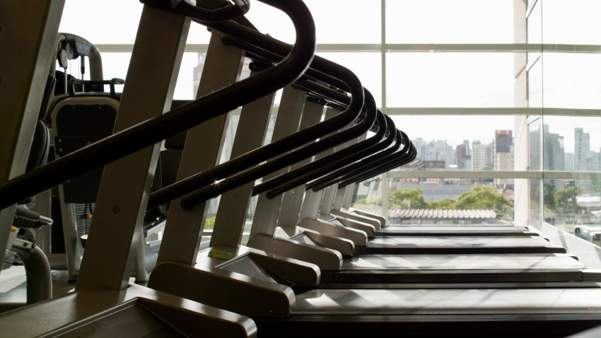 Row of treadmills in gym