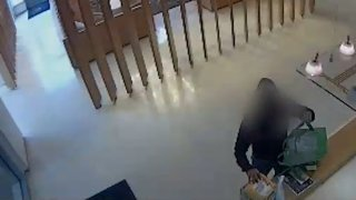 Surveillance video appears to show a man stealing a package containing the ashes of a D.C. man's mother.