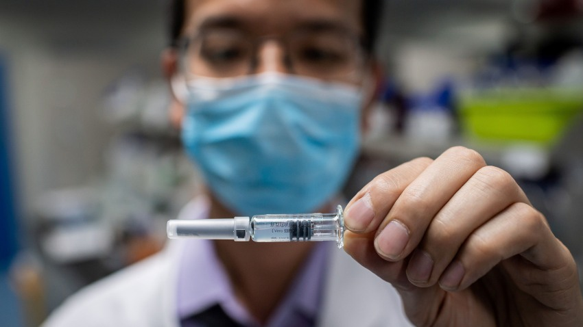 In this picture taken on April 29, 2020, an engineer shows an experimental vaccine for COVID-19 that was tested at the Quality Control Laboratory at the Sinovac Biotech facilities in Beijing.