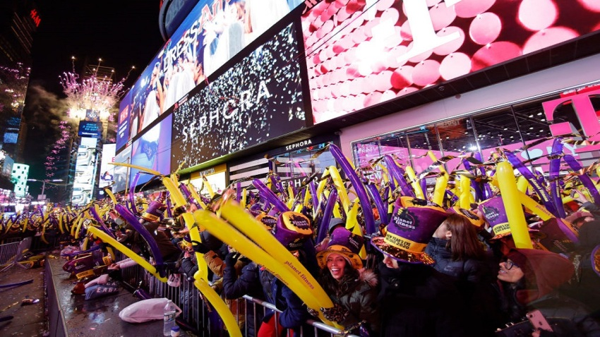 In this Dec. 31, 2019, file photo, revelers wait for the ball drop during New Year's Eve celebrations in Times Square in New York City.