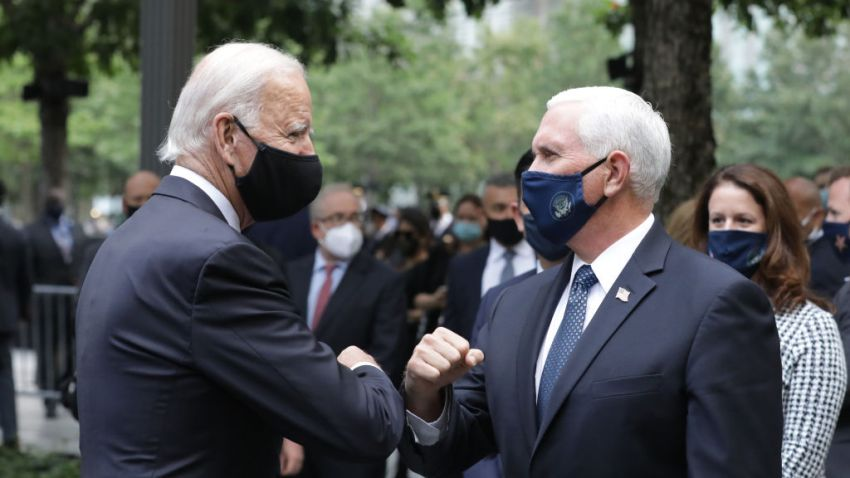 Democratic presidential nominee Joe Biden (L) and U.S. Vice President Mike Pence (R) greet each other during a 9/11 memorial service at the National September 11 Memorial and Museum on September 11, 2020 in New York City.