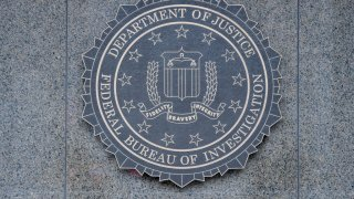Close-up of the seal of the Federal Bureau of Investigation (FBI) of the wall of J Edgar Hoover FBI Building, Washington DC, January 21, 2017.