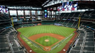 In this July 24, 2020, file photo, a general view of the inaugural game at Globe Life Field as players line the base paths for the pre-game ceremony before the game between the Colorado Rockies and the Texas Rangers at Globe Life Field in Arlington in Arlington, Texas.