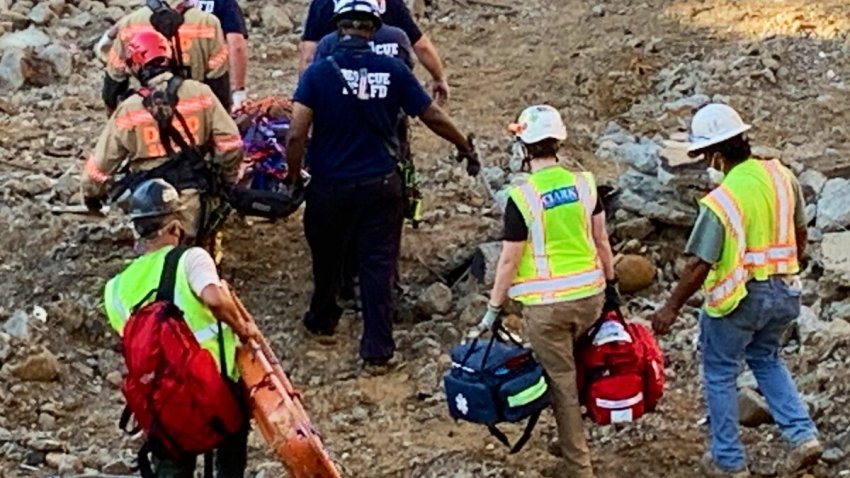 Rescuers are shown at the site of a construction accident near Dupont Circle