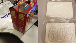 Two packages of cocaine and the boxes of Lucky Charms cereal they were found hidden in