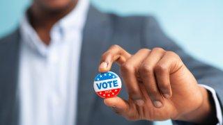 vote button in hand