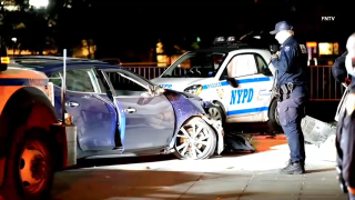 An intoxicated driver slammed into Washington Square Park's landmark marble arch on Sunday, injuring a police officer who was parked there to protect it, police said.