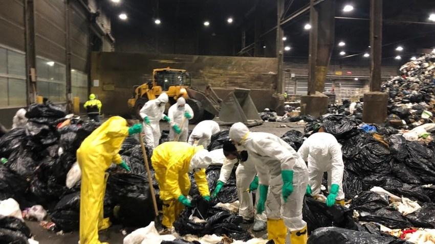 Volunteers looking through trash