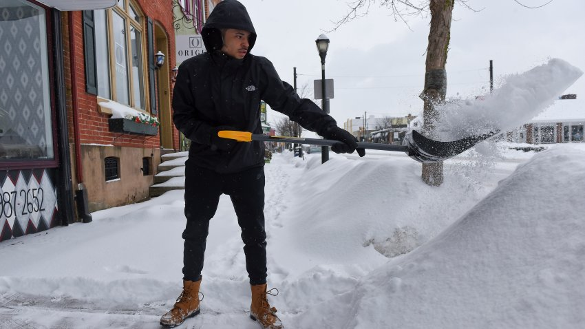 Person throwing a shovel-full of snow