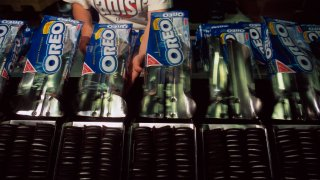 a worker packaging oreos at a Nabisco plant.