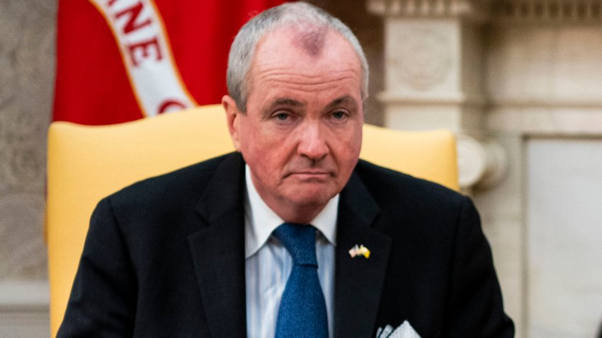 Gov. Phil Murphy on a yellow chair with a frown.