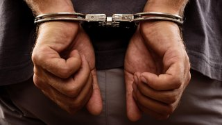 Close-up.,Arrested,Man,Handcuffed,Hands,At,The,Back
