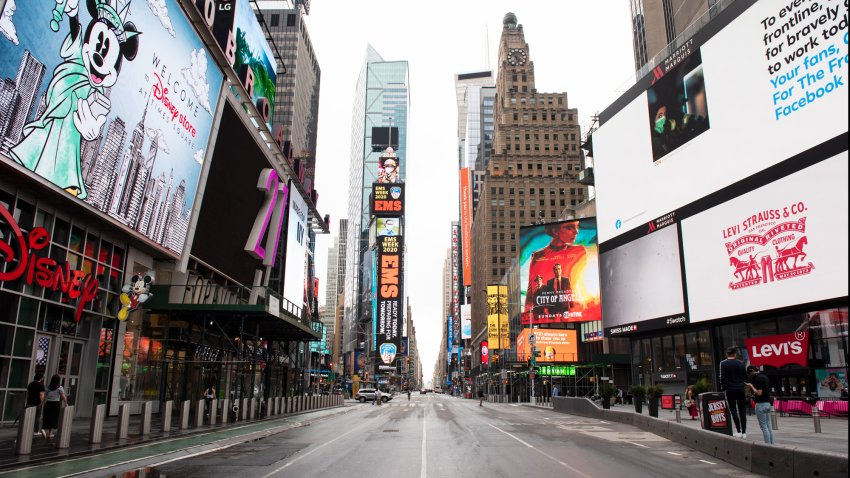 Times Square sits emptied of its usual crowds on May 23, 2020, in New York. Bustling metropolises in countries around the world sat empty as government leaders shut down the tourism and local hospitality in an effort to mitigate the spread of COVID-19.