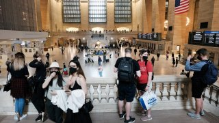 People walk through Grand Central Terminal in Manhattan on May 04, 2021 in New York City.