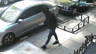 A screenshot from surveillance video shows a suspect wanted by police in a fatal shooting on the Upper East Side.