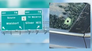 beltway exit and bullet hole in car