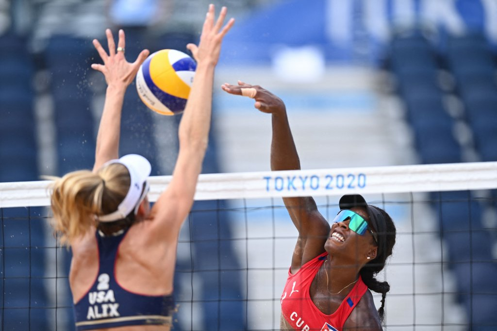 USA's Alix Klineman (L) blocks a shot by Cuba's Leila Consuelo Martinez Ortega in their women's beach volleyball round of 16 match between Cuba and the USA during the Tokyo 2020 Olympic Games at Shiokaze Park in Tokyo on Aug. 2, 2021.