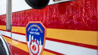 American flags are reflected off a fire truck in New York City