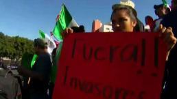 Gritos y empujones en manifestaciones anti migrante
