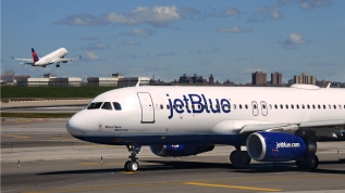 NEW YORK, NY - APRIL 28, 2015: A JetBlue Airways passenger aircraft (Airbus A320) taxis at LaGuardia Airport in New York City, New York. (Photo by Robert Alexander/Getty