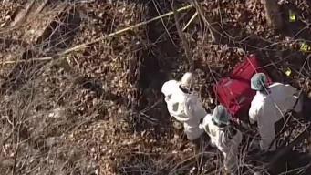 Buscan identificar mujer hallada en maleta en bosque