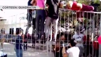 Cubanos saltan rejas en instalaciones de migración en México