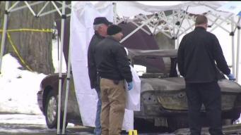 Hallan cadáver en auto quemado en Worcester