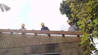 Jóvenes universitarios construyen casas en Morovis