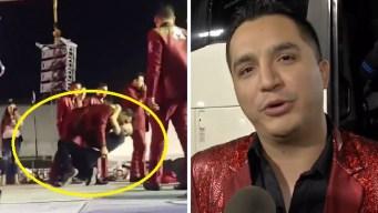 Cantante de La Arrolladora besa a un fan gay en concierto