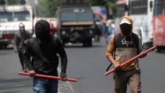 Encapuchados perturban marcha por desaparecidos