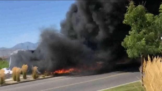 [TLMD - NATL] Casa inflable estalla en llamas en Draper tras insólito accidente