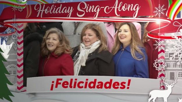 Afortunadas ganadoras cantan debajo del árbol de Nueva York