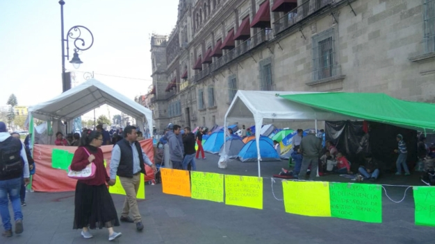 México: desplazados cambian cara de Palacio Nacional